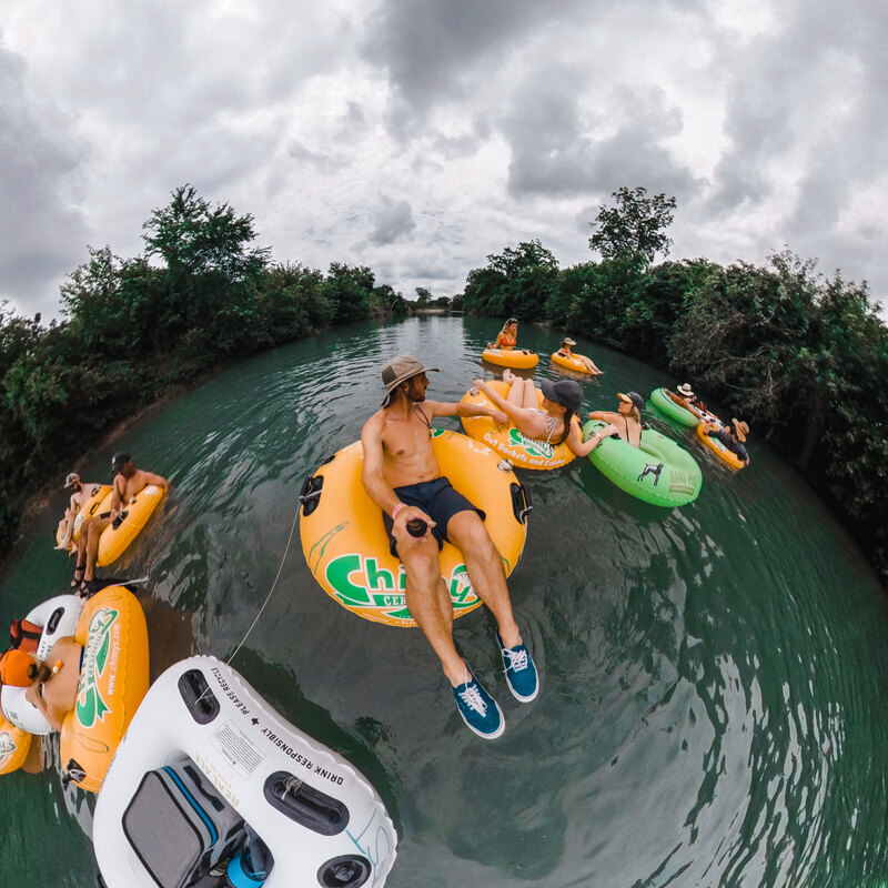 Group floating on the San Marcos River